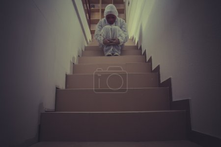 Photo for Depression, mental disorders, man with red mask and white paper suit - Royalty Free Image