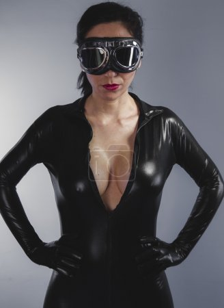 Beautiful woman in latex black suit