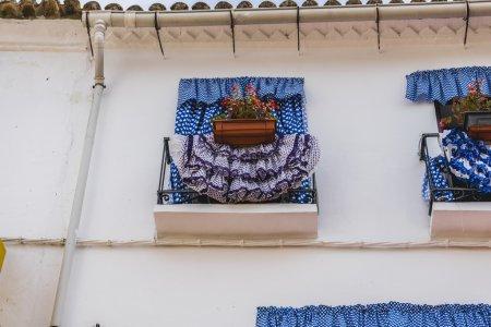 Balconies with flamenco dresses