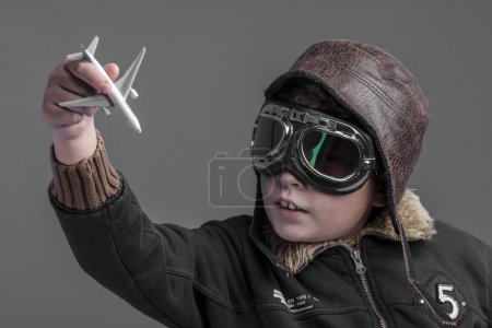 child playing the aircraft