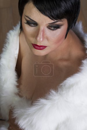 Girl with white fur posing