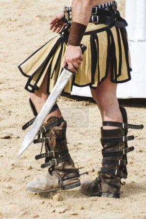 gladiator walking on  arena