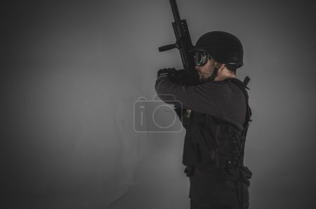 airsoft player holding gun