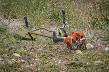 brush cutter in a garden