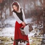 Постер, плакат: girl in a red hood holding a apple