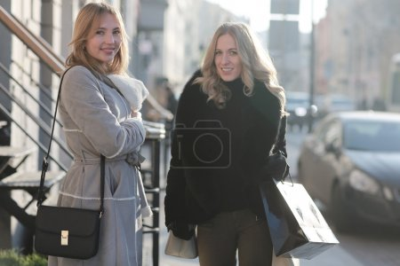 young women walking in city