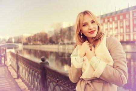 Happy beautiful girl walking in city