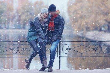 Attractive couple walking in city