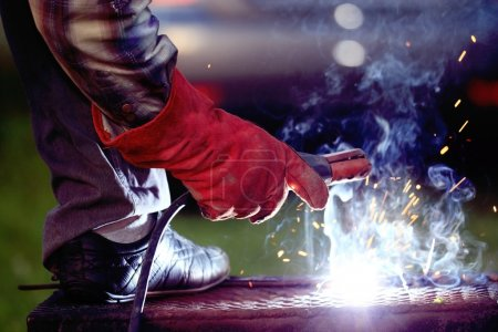 Welder working with welder machine