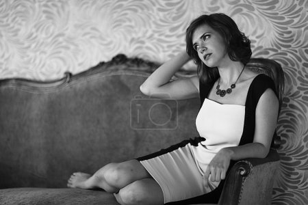 Glamour girl sitting on the coach