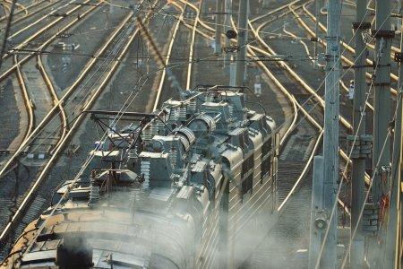 Railroad rails with train