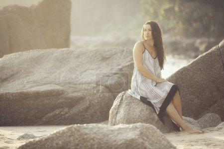 Young beautiful girl on beach