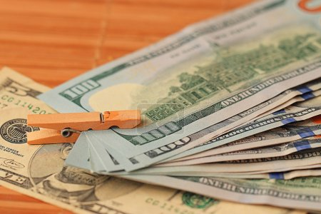 Photo for Dollar banknotes heap with wooden pin - Royalty Free Image