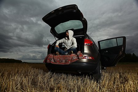 Man traveler in car trunk