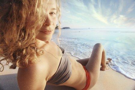 girl sunbathing at the beach