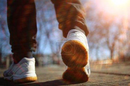 athletic legs in  sneakers