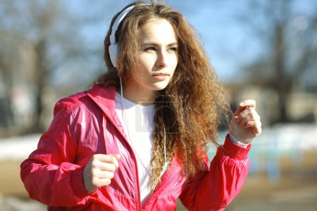 Photo for Girl athlete  running outside in spring - Royalty Free Image