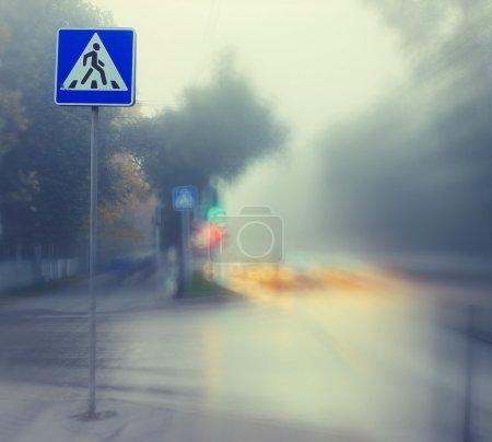 autumn fog on city road