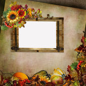 Vintage background with frame, flowers, leaves, berries and pumpkins