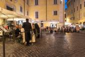 People eat in street restaurants in Rome