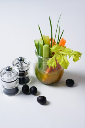 carrots , augures and onions in a glass