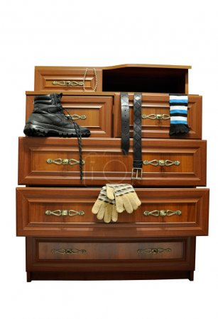 Photo for Brown wooden chest of drawers with things. - Royalty Free Image