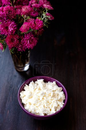 Delicious homemade cottage cheese on the wooden table