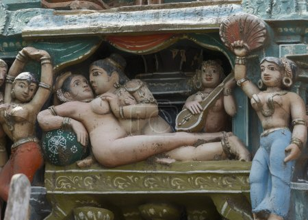 Couple makes love statue on Sarangapani temple Gopuram.