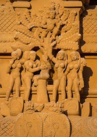 Krishna flees angry, naked women statue.