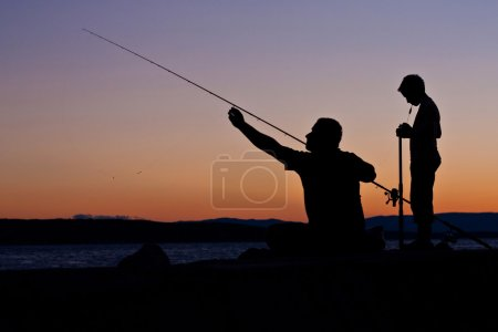 The fishermen at sunset - father and son...