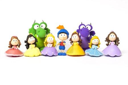 Prince, princesses and dragon on white
