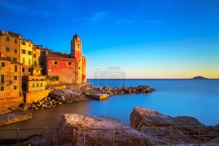 Tellaro rocks and old village on the sea. Church a...