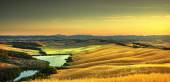 Tuscany, rural landscape on sunset, Italy. Lake and green fields