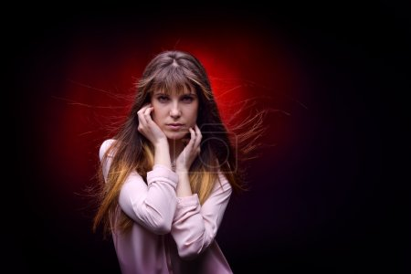 Photo for Portrait of young brunette pretty woman in studio - Royalty Free Image
