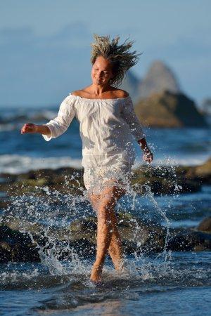 young caucasian woman refreshing