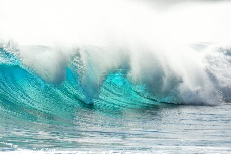 big wave breaking and surfer