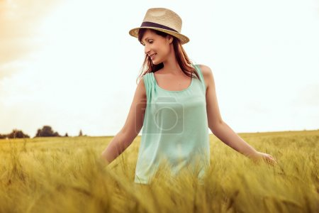 Photo for Natural rural female walking field carefree - Royalty Free Image