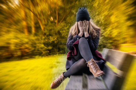 Photo for Depressed female in autumn season - Royalty Free Image