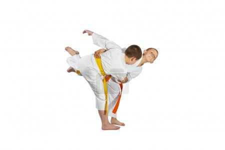 Boys athletes are training throws of judo