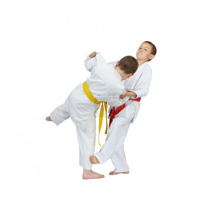 Slicing down under leg are training athletes in judogi