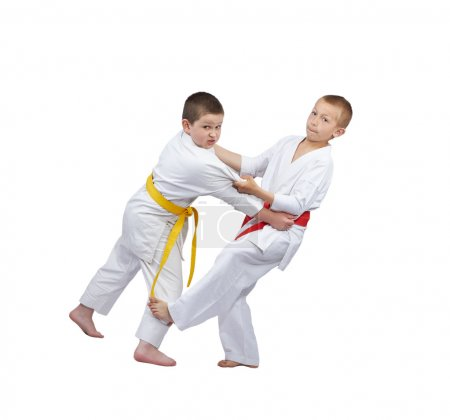 Children athletes are training slicing down under leg