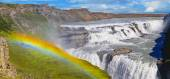 Beautiful Gullfoss waterfall  and rainbow on a sunny day in Iceland
