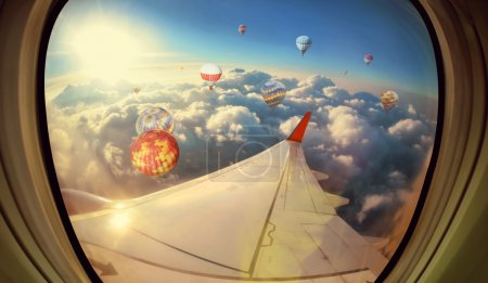 Clouds ,sky and Balloons as seen through window of an aircraft