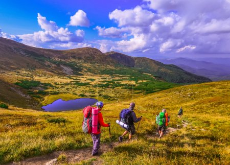Group of hikers in the mountains, view of Carpathians mountains