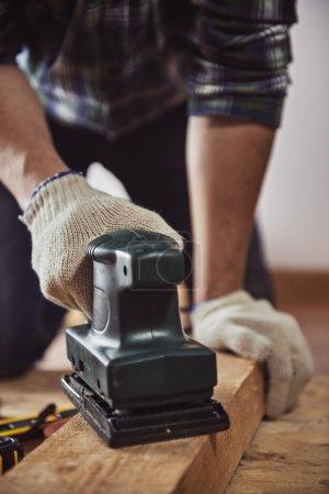 Male builder working in studio