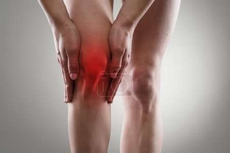 Tendon problems on woman's leg indicated with red ...