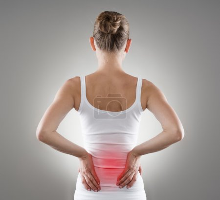 Photo for Loin spasm. Young woman with hurt backbone. Spine inflammation, pain and therapy. - Royalty Free Image