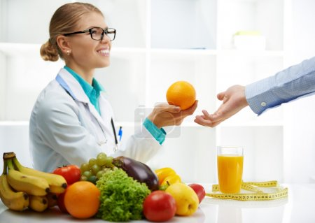 Dietitian with patient