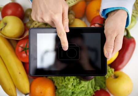 Doctor dietitian with tablet pc