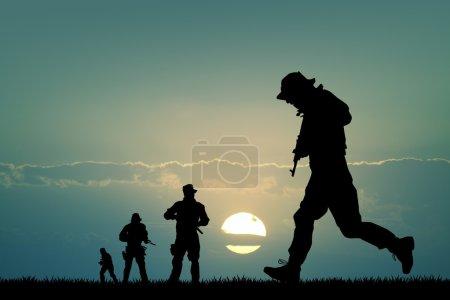 Photo pour Silhouette de soldats au coucher du soleil - image libre de droit